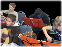 Students learning guitar in a group.